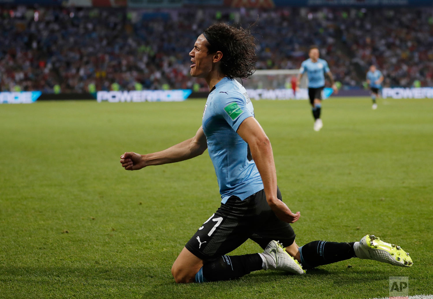 Uruguay's Edinson Cavani celebrates after he scored the opening goal during the round of 16 match between Uruguay and Portugal at the 2018 soccer World Cup at the Fisht Stadium in Sochi, Russia, Saturday, June 30, 2018. (AP Photo/Francisco Seco)