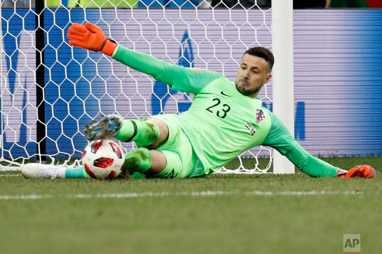 Croatia goalkeeper Danijel Subasic saves the decisive penalty during a penalty shoot out after extra time during the round of 16 match between Croatia and Denmark at the 2018 soccer World Cup in the Nizhny Novgorod Stadium, in Nizhny Novgorod , Russia, Sunday, July 1, 2018. (AP Photo/Efrem Lukatsky)