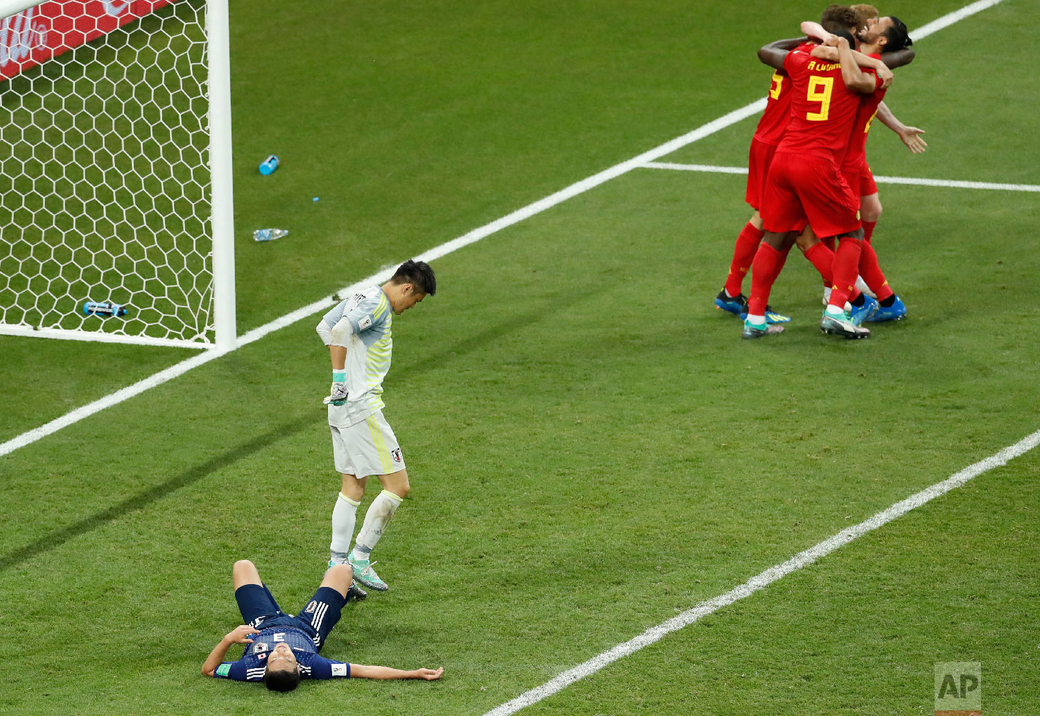 Belgium's Nacer Chadli, top right, is cheered by teammates after scoring his third side goal during the round of 16 match between Belgium and Japan at the 2018 soccer World Cup in the Rostov Arena, in Rostov-on-Don, Russia, Monday, July 2, 2018. (AP Photo/Hassan Ammar)