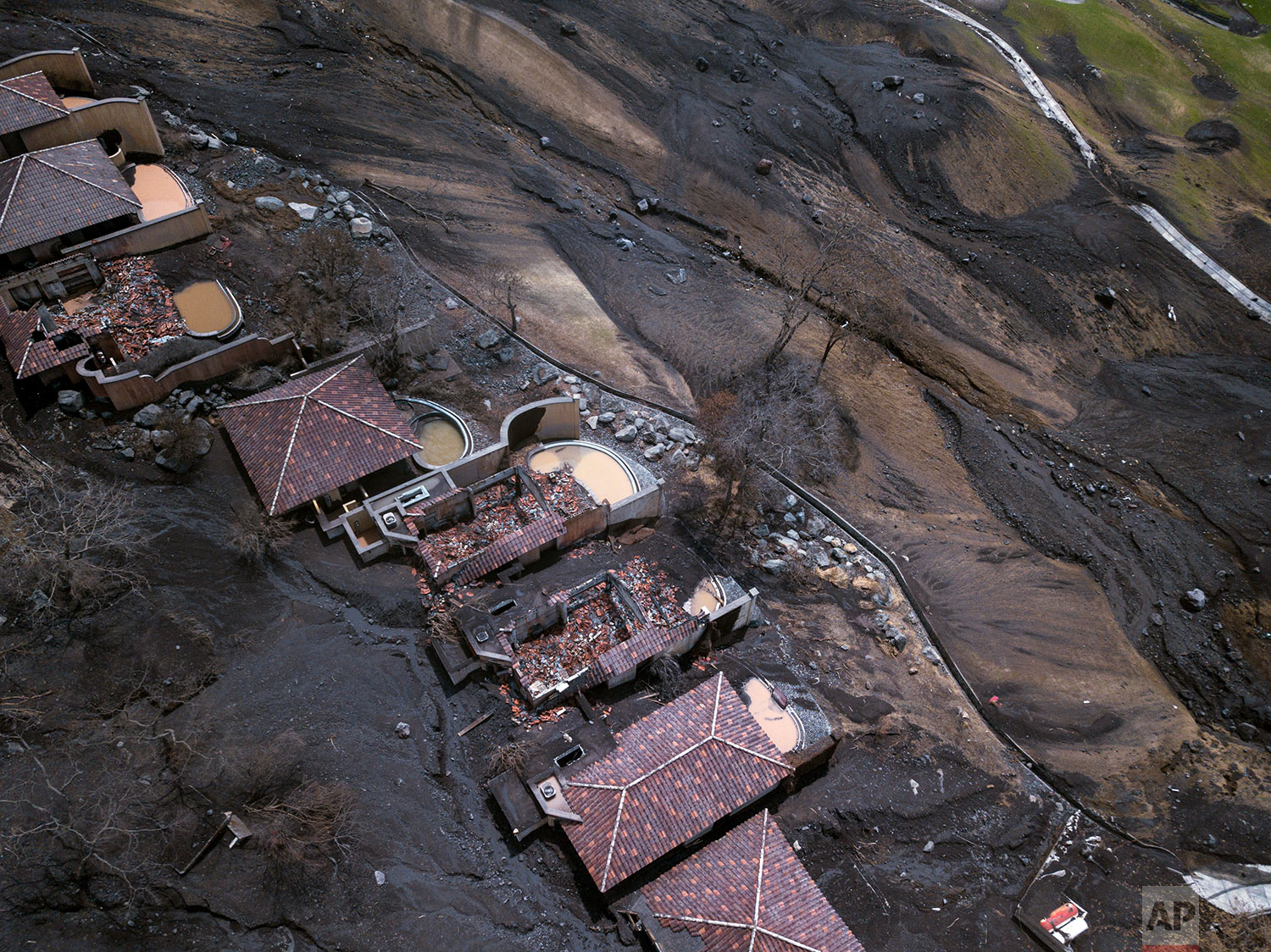 Golf resort homes homes and pools are covered by volcanic debris in San Miguel Los Lotes. June 19, 2018. (AP Photo/Rodrigo Abd