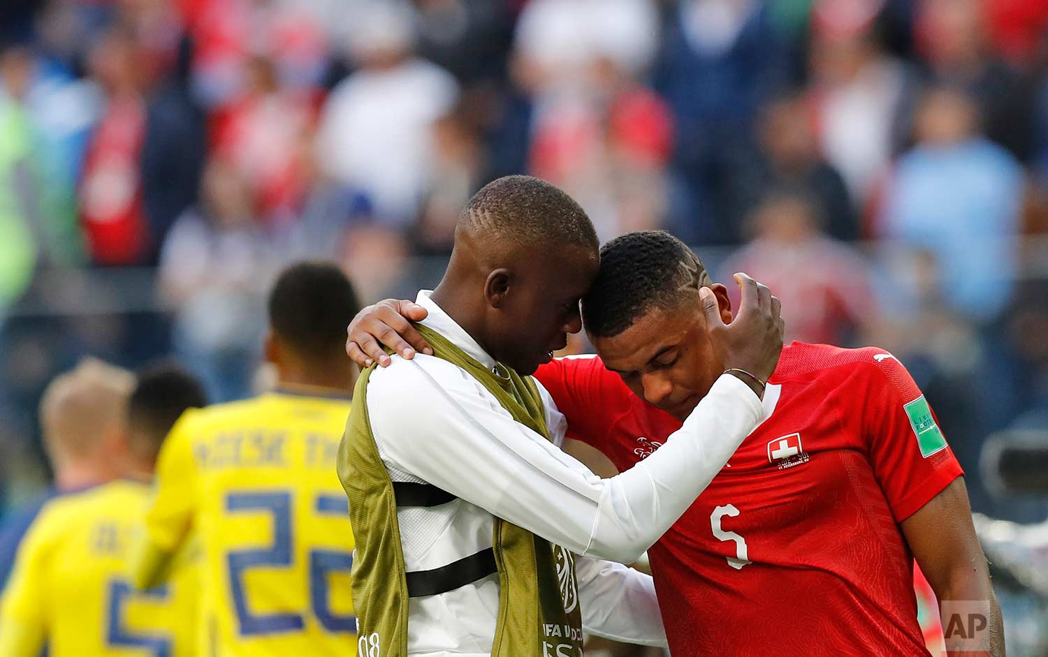 Switzerland's Manuel Akanji, right, reacts at the end of the match after Sweden defeated Switzerland during the round of 16 match between Switzerland and Sweden at the 2018 soccer World Cup in the St. Petersburg Stadium, in St. Petersburg, Russia, Tuesday, July 3, 2018. (AP Photo/Efrem Lukatsky)