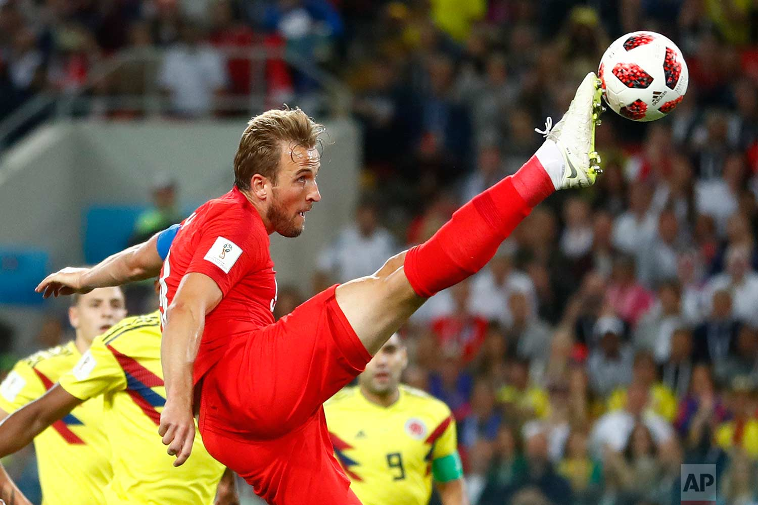England's Harry Kane tries to control the ball during the round of 16 match between Colombia and England at the 2018 soccer World Cup in the Spartak Stadium, in Moscow, Russia, Tuesday, July 3, 2018. (AP Photo/Matthias Schrader)