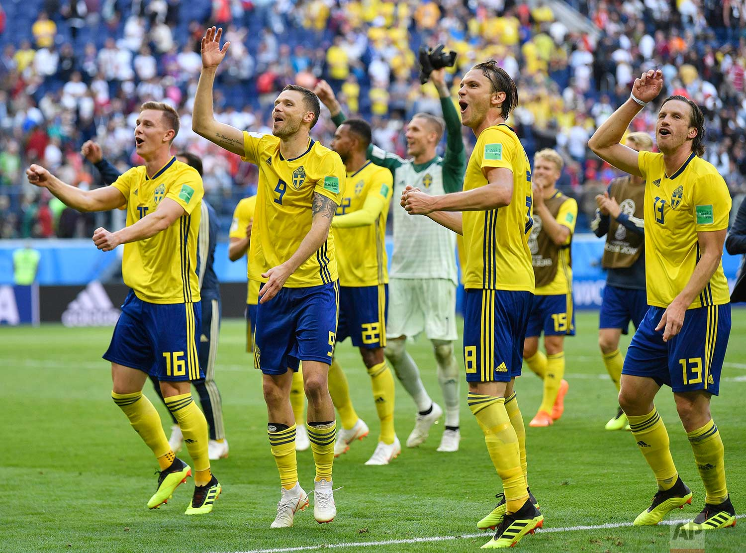 Sweden teammates celebrate after winning the round of 16 match between Switzerland and Sweden at the 2018 soccer World Cup in the St. Petersburg Stadium, in St. Petersburg, Russia, Tuesday, July 3, 2018. (AP Photo/Martin Meissner)