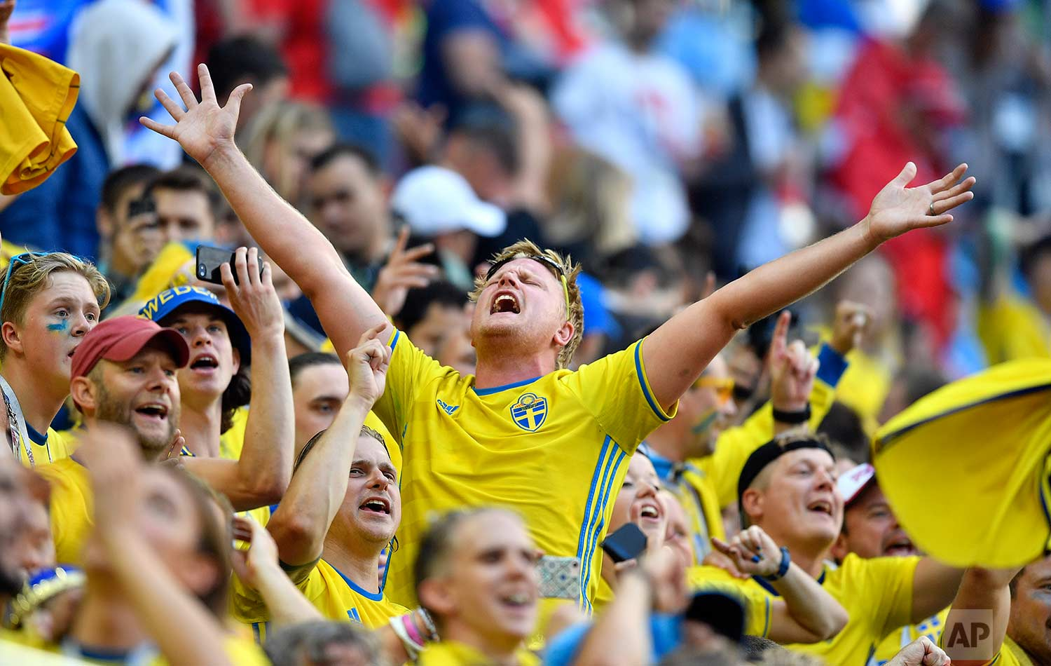 Sweden supporters celebrate after their team won the round of 16 match between Switzerland and Sweden at the 2018 soccer World Cup in the St. Petersburg Stadium, in St. Petersburg, Russia, Tuesday, July 3, 2018. (AP Photo/Martin Meissner)