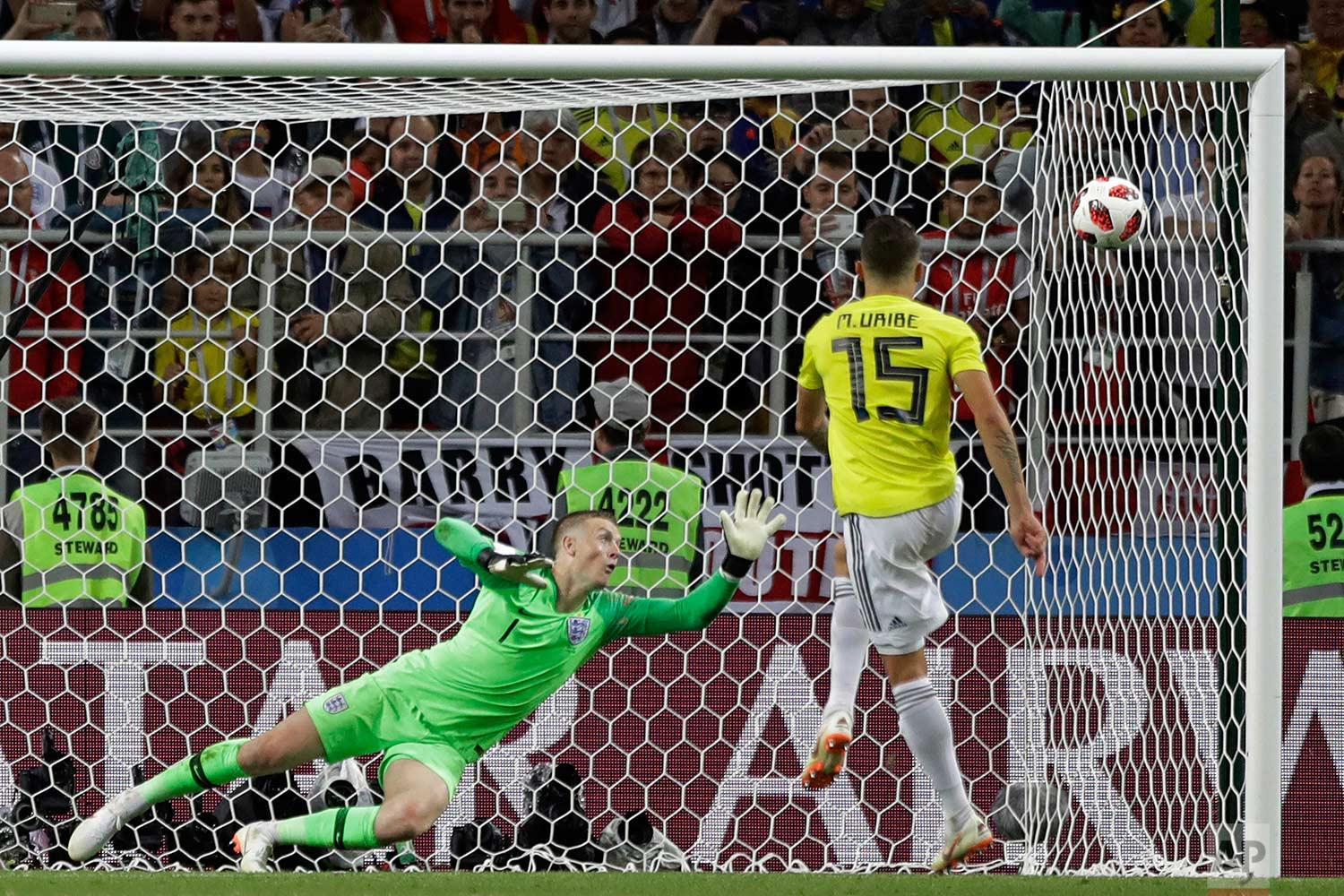 Colombia's Mateus Uribe fails to score on a penalty in the round of 16 match between Colombia and England at the 2018 soccer World Cup in the Spartak Stadium, in Moscow, Russia, Tuesday, July 3, 2018. England eliminates Colombia 4-3 on penalties after the game ends 1-1. (AP Photo/Matthias Schrader)