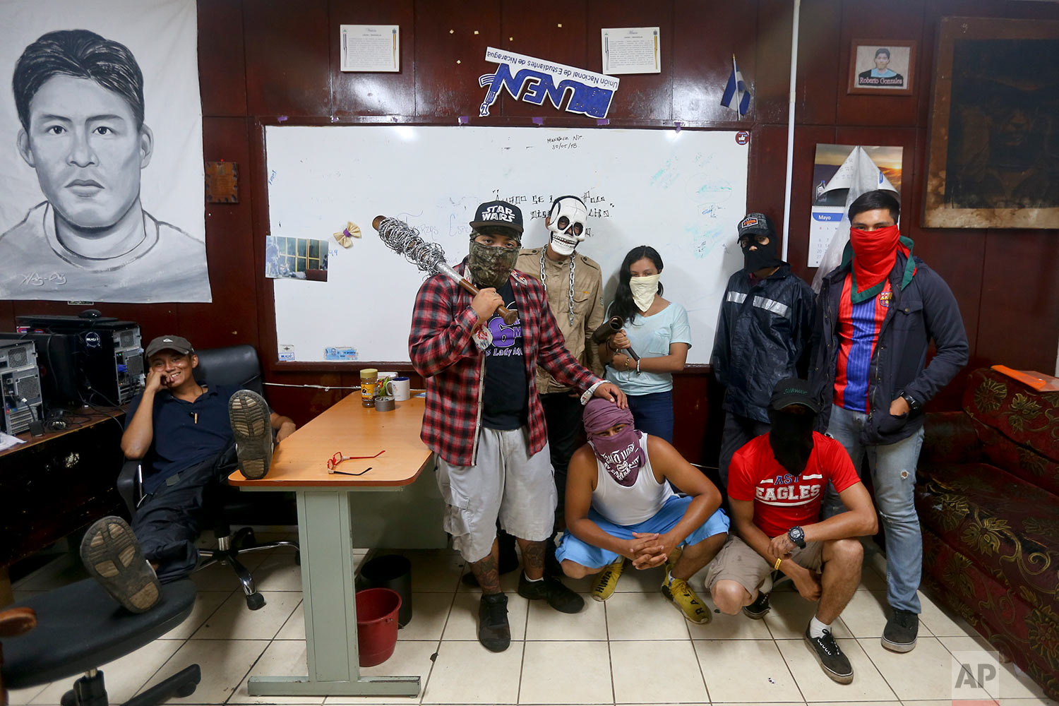 In this June 7, 2018 photo, anti-government students of the Autonomous University of Nicaragua pose for a picture at the school where they've barricaded themselves inside in Managua, Nicaragua. (AP Photo/Esteban Felix)