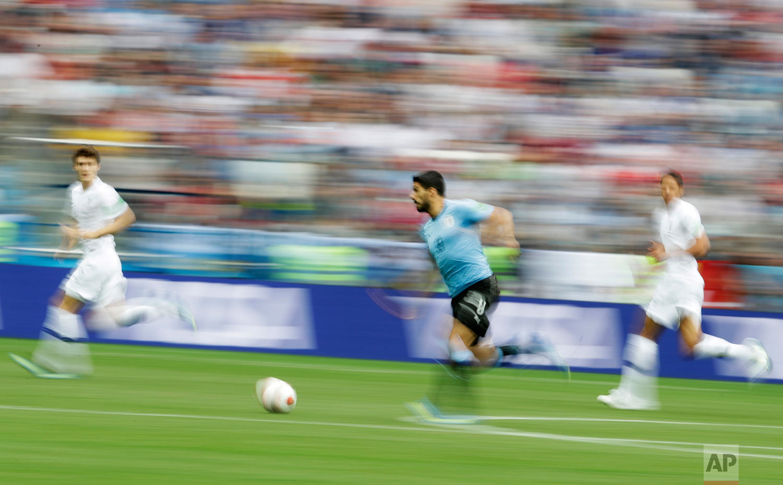Uruguay's Luis Suarez, center, controls the ball during the quarterfinal match between Uruguay and France at the 2018 soccer World Cup in the Nizhny Novgorod Stadium, in Nizhny Novgorod, Russia, Friday, July 6, 2018. (AP Photo/Petr David Josek)