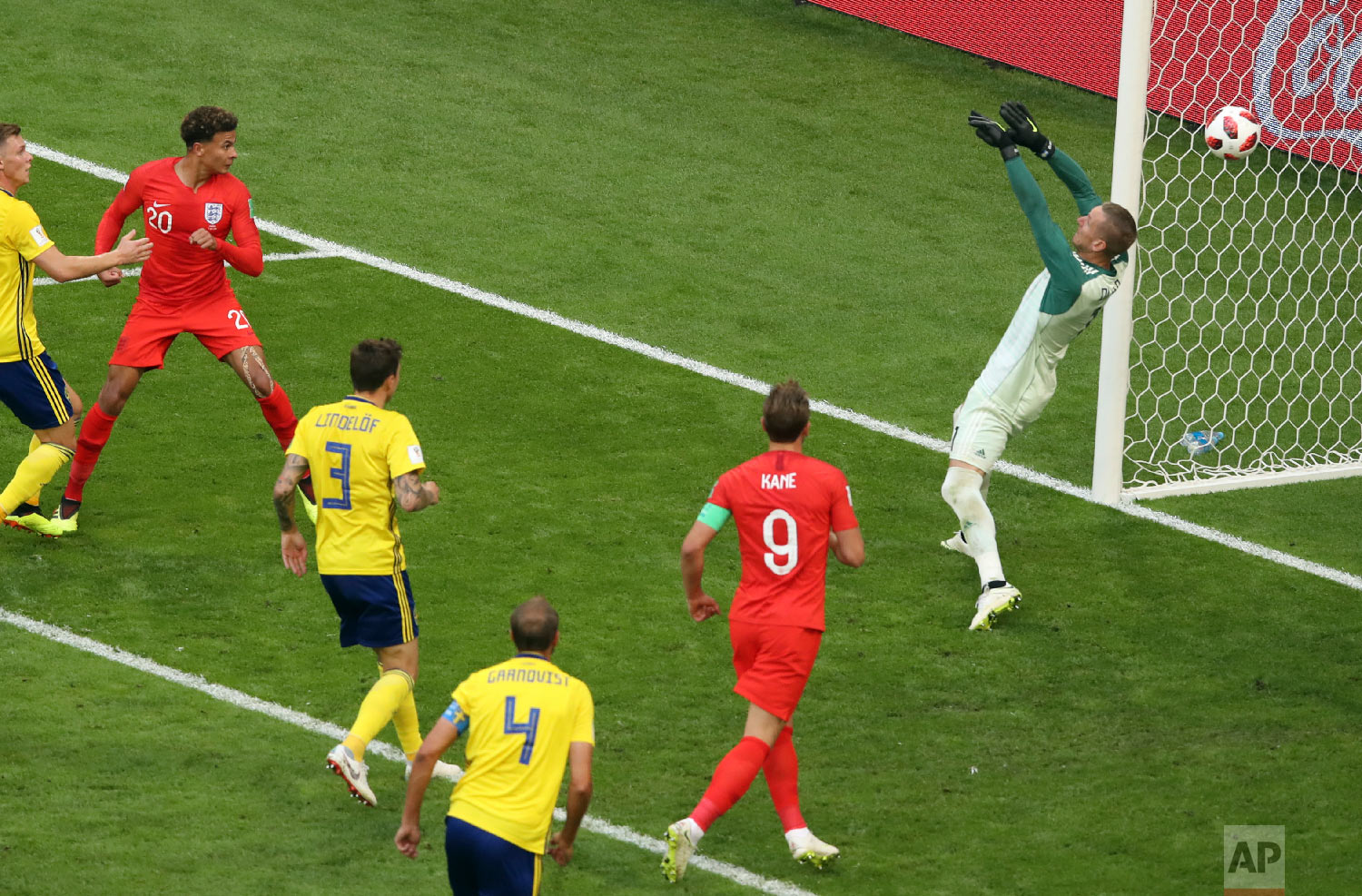 England's Dele Alli, 2nd left, scores his side's second goal during the quarterfinal match between Sweden and England at the 2018 soccer World Cup in the Samara Arena, in Samara, Russia, Saturday, July 7, 2018. (AP Photo/Thanassis Stavrakis)