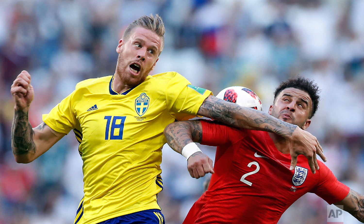 Sweden's Pontus Jansson, left, challenges for the ball with England's Kyle Walker during the quarterfinal match between Sweden and England at the 2018 soccer World Cup in the Samara Arena, in Samara, Russia, Saturday, July 7, 2018. (AP Photo/Alastair Grant)