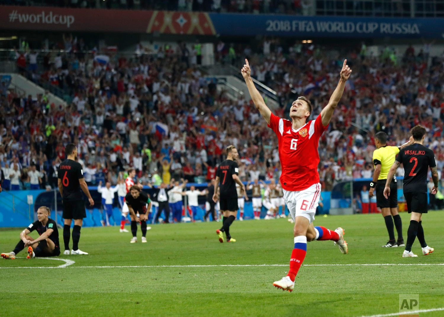 Russia's Denis Cheryshev celebrates after scoring his side's first goal during the quarterfinal match between Russia and Croatia at the 2018 soccer World Cup in the Fisht Stadium, in Sochi, Russia, Saturday, July 7, 2018. (AP Photo/Pavel Golovkin)