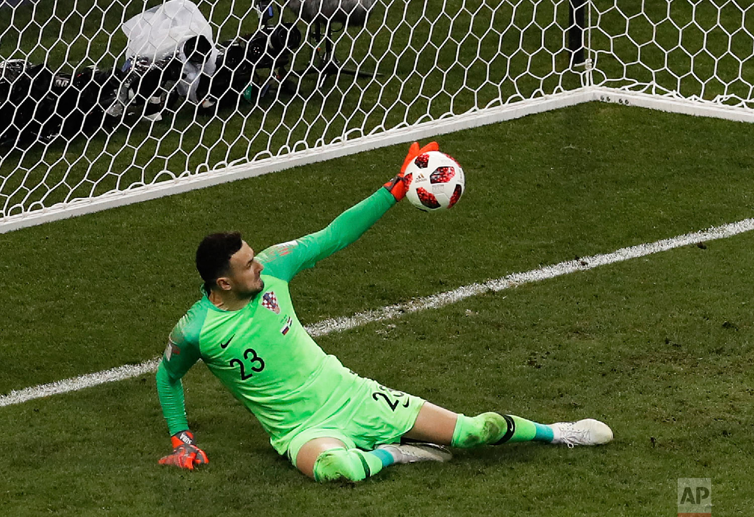 Croatia goalkeeper Danijel Subasic stops a shot from Russia's Fyodor Smolov during a penalty shootout at the end of the quarterfinal match between Russia and Croatia at the 2018 soccer World Cup at the Fisht Stadium in Sochi, Russia, Saturday, July 7, 2018. (AP Photo/Alexander Zemlianichenko)