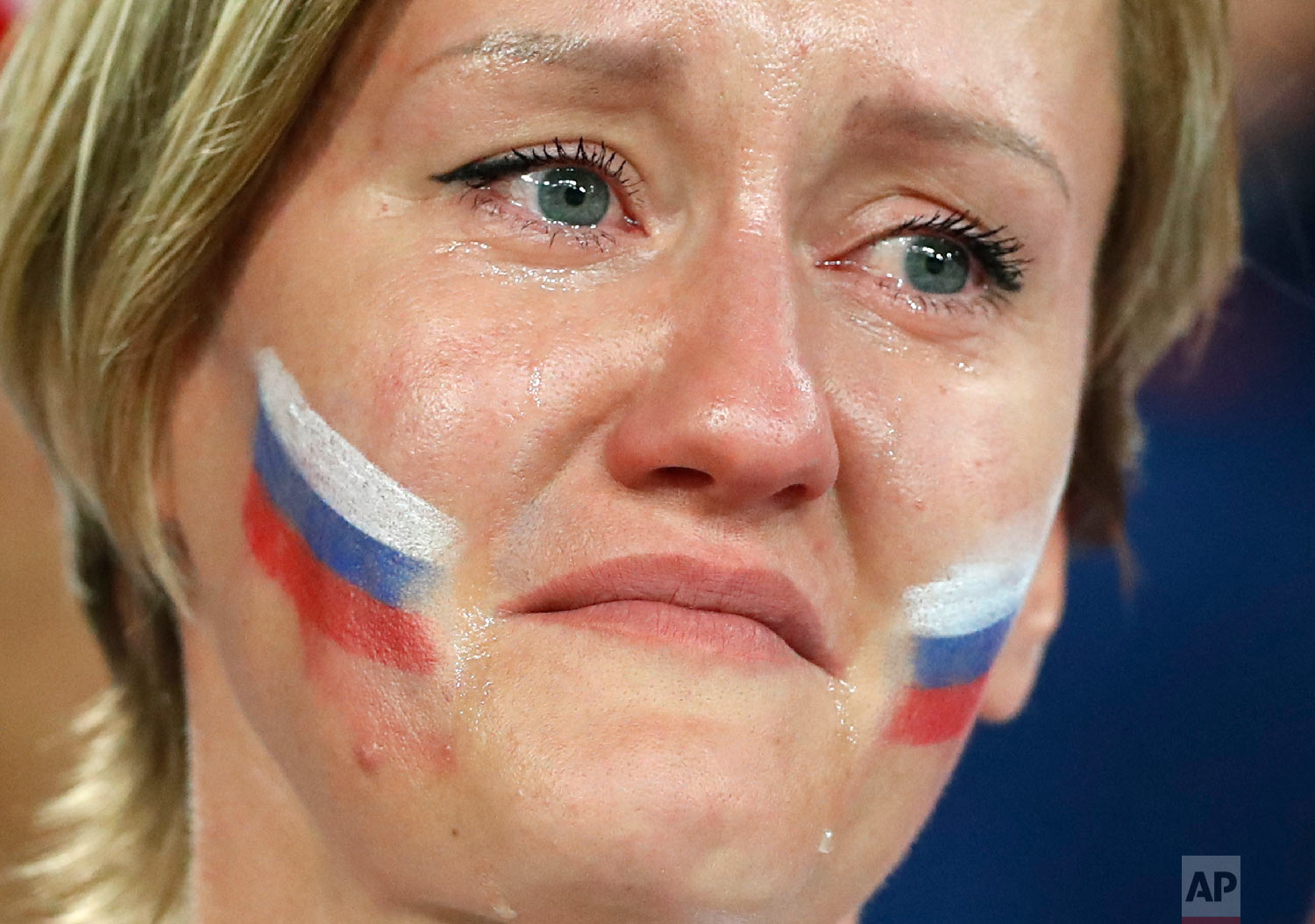 A Russia's fan cries after Russia's loss in the quarterfinal match between Russia and Croatia at the 2018 soccer World Cup in the Fisht Stadium, in Sochi, Russia, Saturday, July 7, 2018. (AP Photo/Darko Bandic)