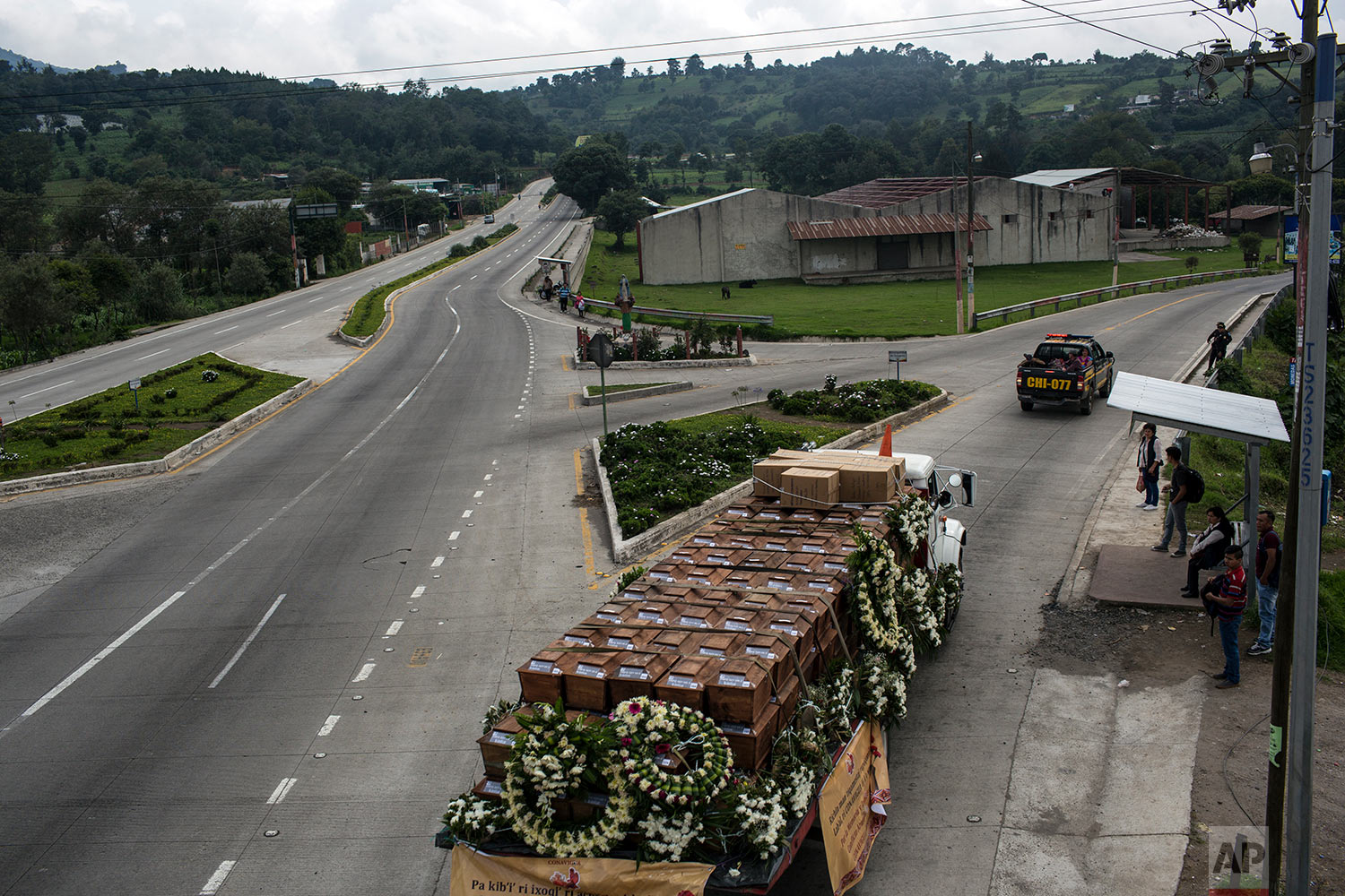 The remains of the 172 unidentified people are returned to San Juan Comalapa, Guatemala for a proper burial at the former military camp where they were discovered in a mass grave. June 20, 2018. (AP Photo/Rodrigo Abd)