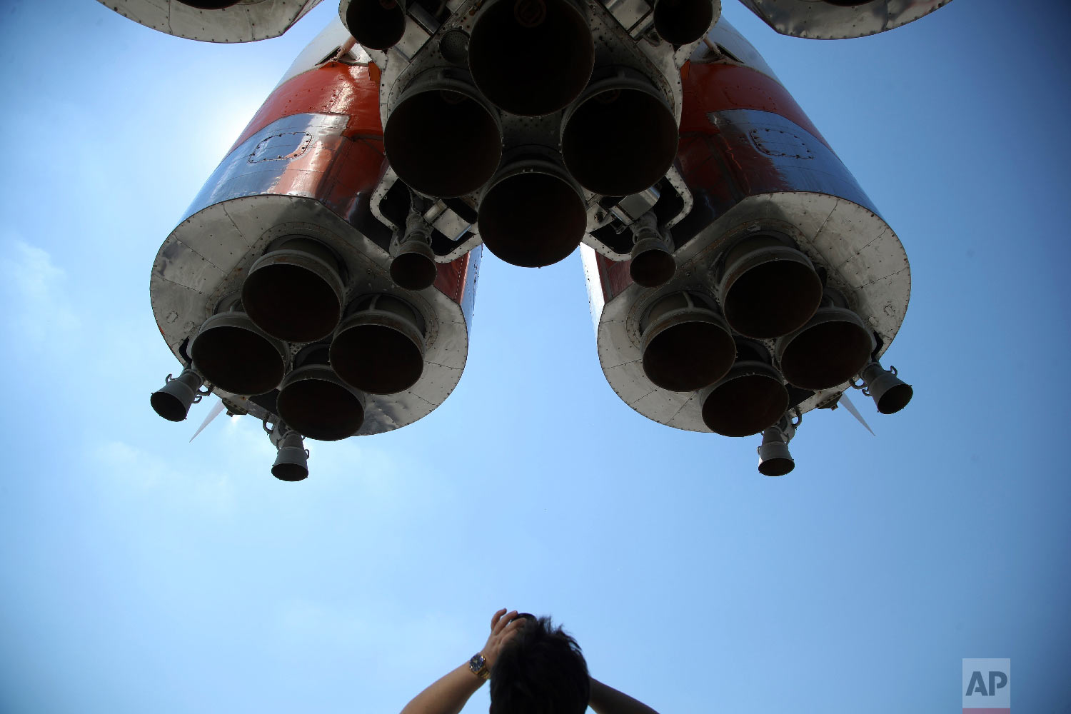 A tourist takes a photograph of a real Vostok rocket outside the Space Museum during the 2018 soccer World Cup in Samara, Russia on Sunday, July 8, 2018. The southeastern city of Russia is known for the production of aerospace launch vehicles, satellites and various space services. (AP Photo/Thanassis Stavrakis)