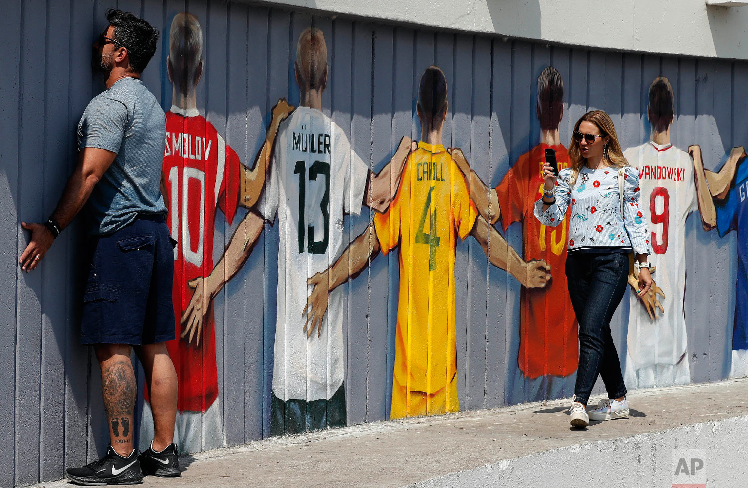 A soccer fan poses for pictures during the 2018 soccer World Cup in Kazan, Russia on Thursday, July 5, 2018. (AP Photo/Frank Augstein)