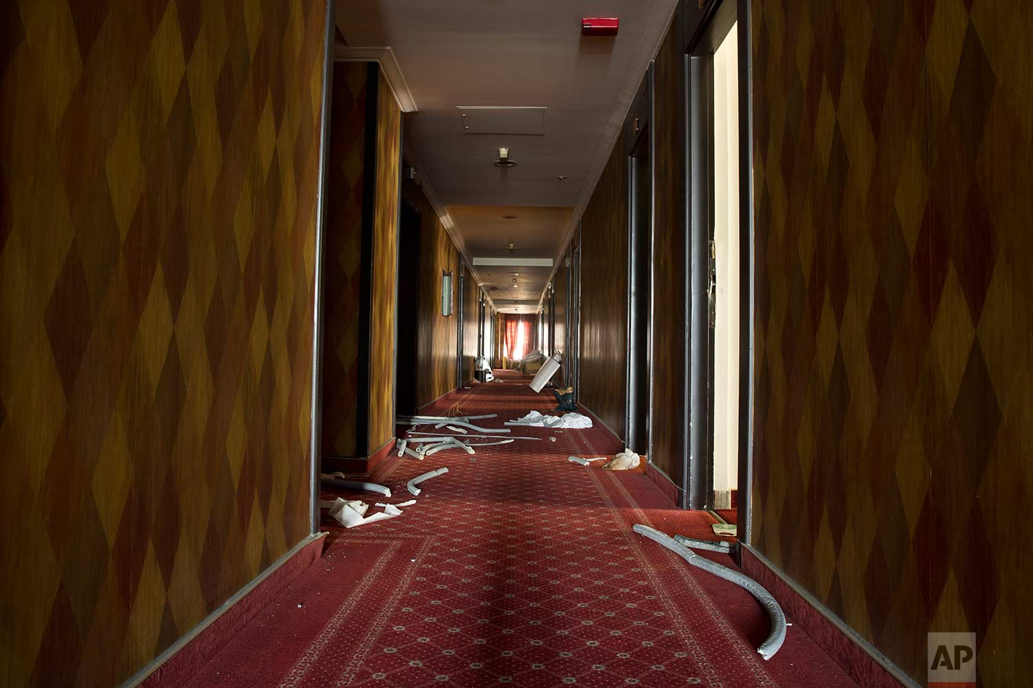 A corridor of the former Hesperia Hotel, which closed abruptly during Greece's financial crisis. (AP Photo/Petros Giannakouris)