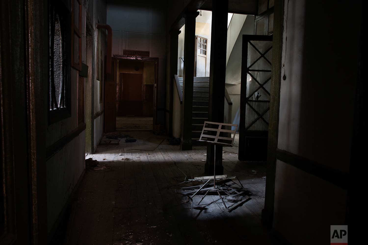 An ancient sheet-music stand is erected, at the entrance to a derelict music school in one of the oldest houses in Athens, dating to 1837. (AP Photo/Petros Giannakouris)