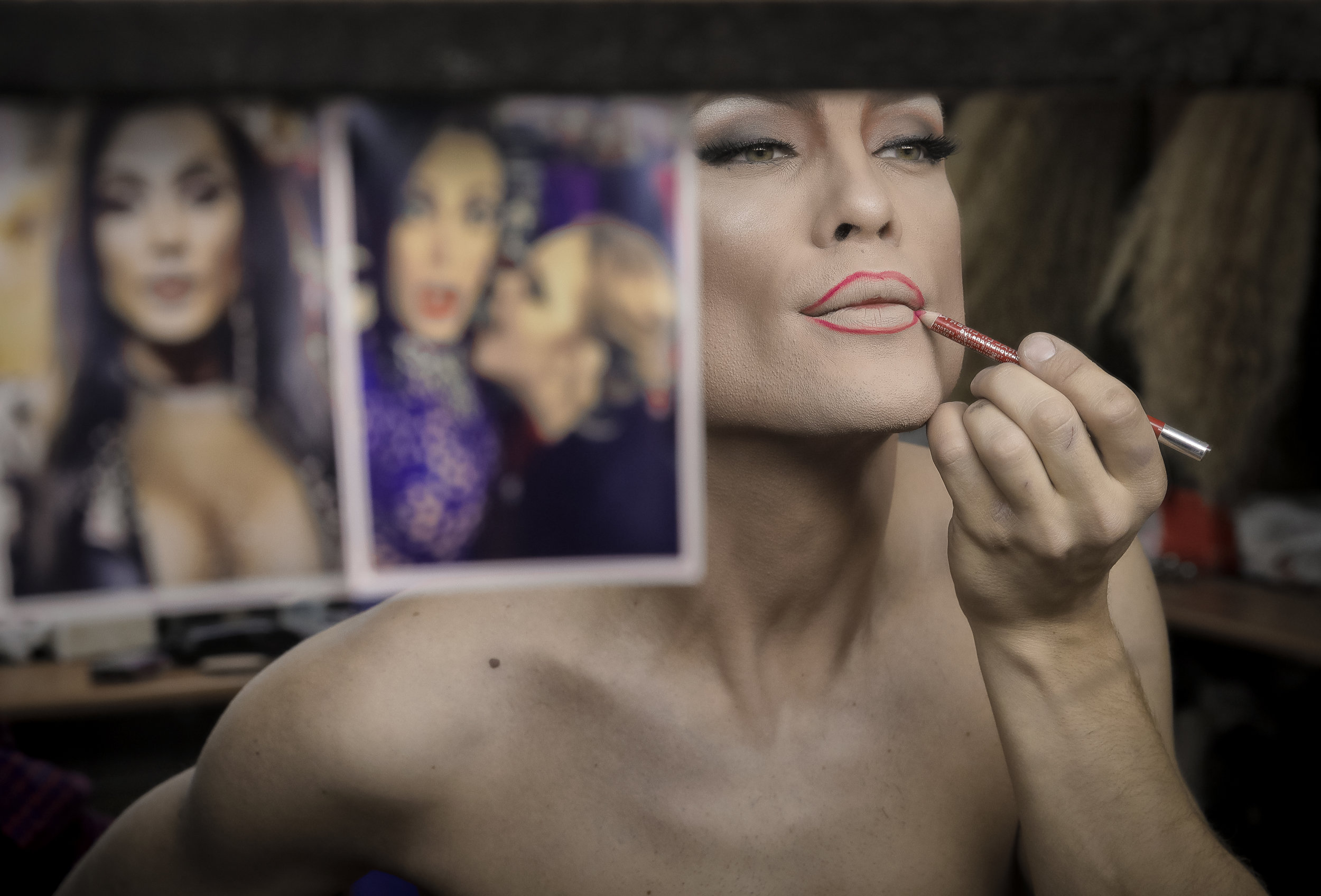Andrei, who goes by the name of Star Vasha applies lip liner backstage before performing at the Fame gay club during the 2018 soccer World Cup in Yekaterinburg, Russia. (AP Photo/Vadim Ghirda)