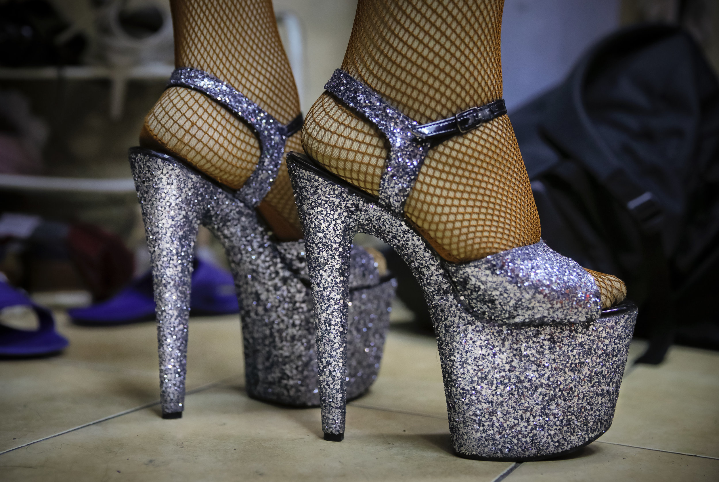 Sergey, who uses the stage name Bomba (the bomb) wears thigh-high boots at the Fame gay club, during the 2018 soccer World Cup in Yekaterinburg, Russia on Sunday, June 24, 2018. (AP Photo/Vadim Ghirda)