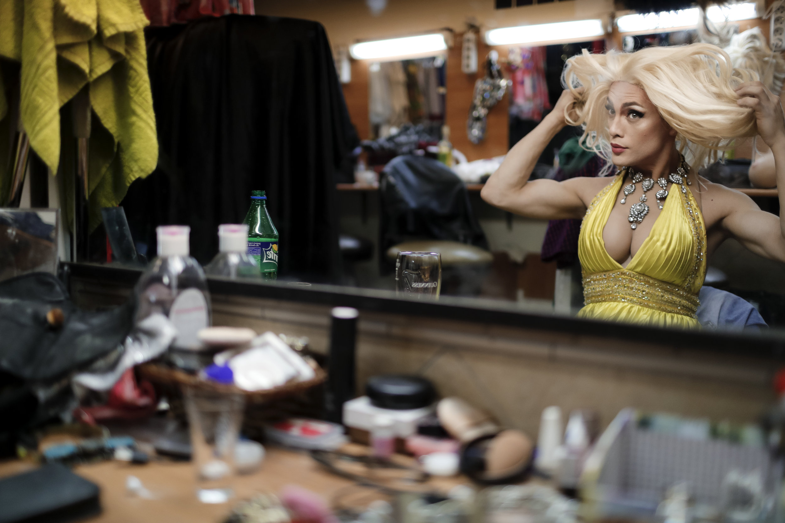 Andrei, who uses the stage name Star Vasha, checks a wig at the Fame gay club, during the 2018 soccer World Cup in Yekaterinburg, Russia on Sunday, June 24, 2018 (AP Photo/Natacha Pisarenko)