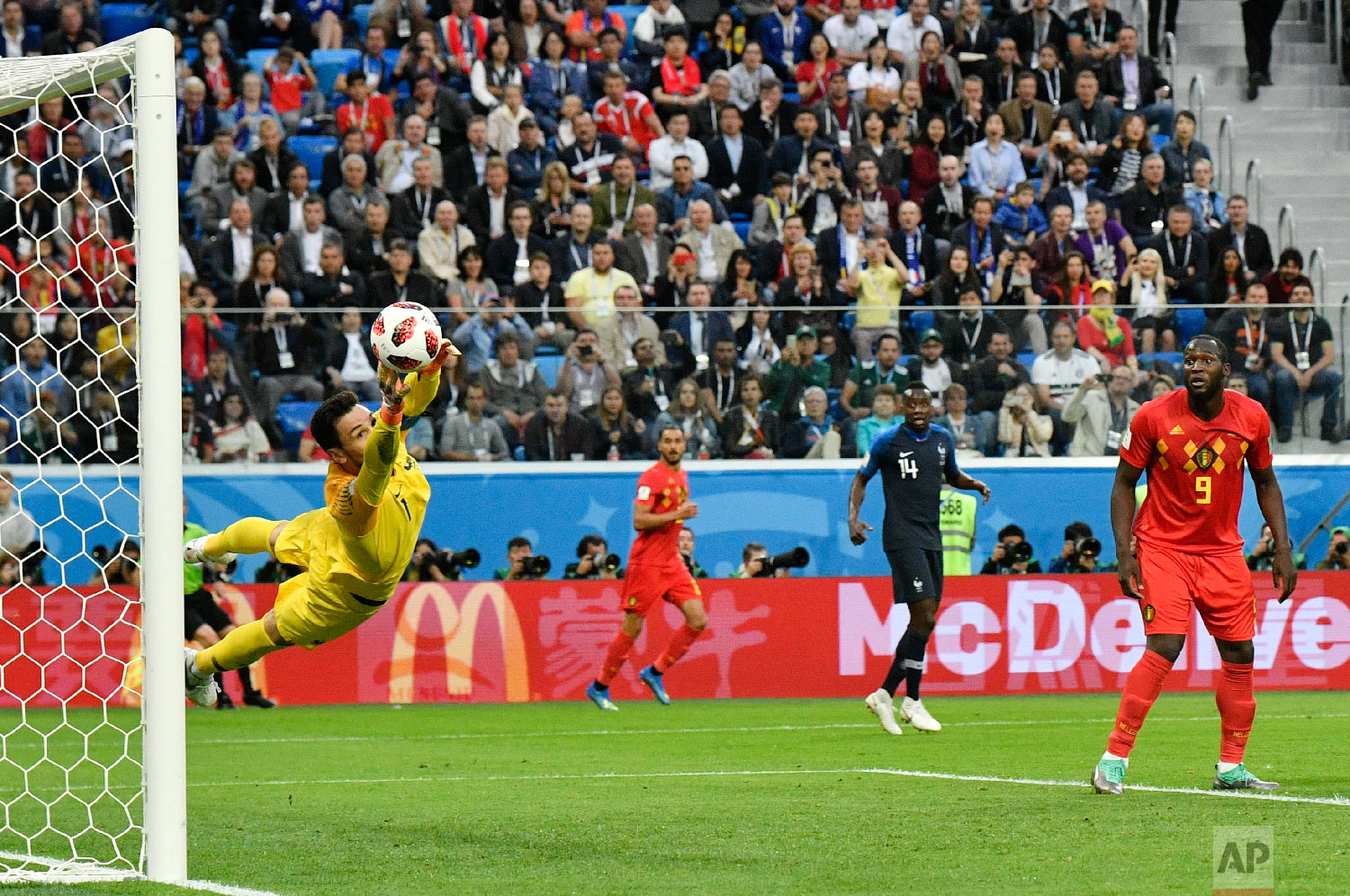 France goalkeeper Hugo Lloris deflects a shot by Belgium's Toby Alderweireld during the semifinal match between France and Belgium at the 2018 soccer World Cup in the St. Petersburg Stadium in St. Petersburg, Russia, Tuesday, July 10, 2018. (AP Photo/Martin Meissner)