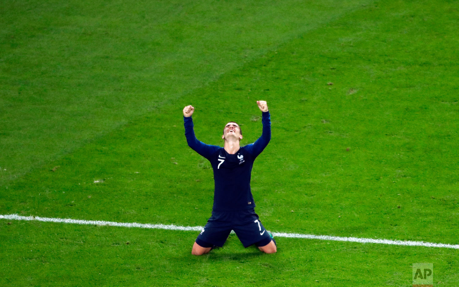 France's Antoine Griezmann celebrates at the end of the semifinal match between France and Belgium at the 2018 soccer World Cup in the St. Petersburg Stadium in St. Petersburg, Russia, Tuesday, July 10, 2018. (AP Photo/Pavel Golovkin)