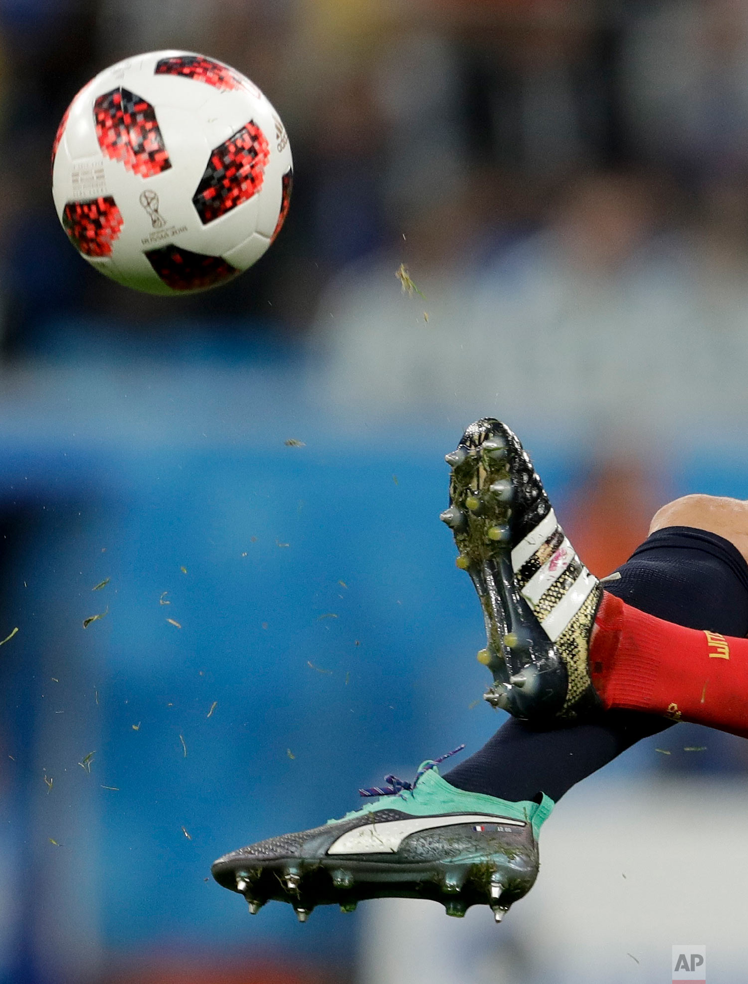 Belgium's Vincent Kompany, in red, challenges France's Olivier Giroud during the semifinal match between France and Belgium at the 2018 soccer World Cup in the St. Petersburg Stadium, in St. Petersburg, Russia, Tuesday, July 10, 2018. (AP Photo/Petr David Josek)