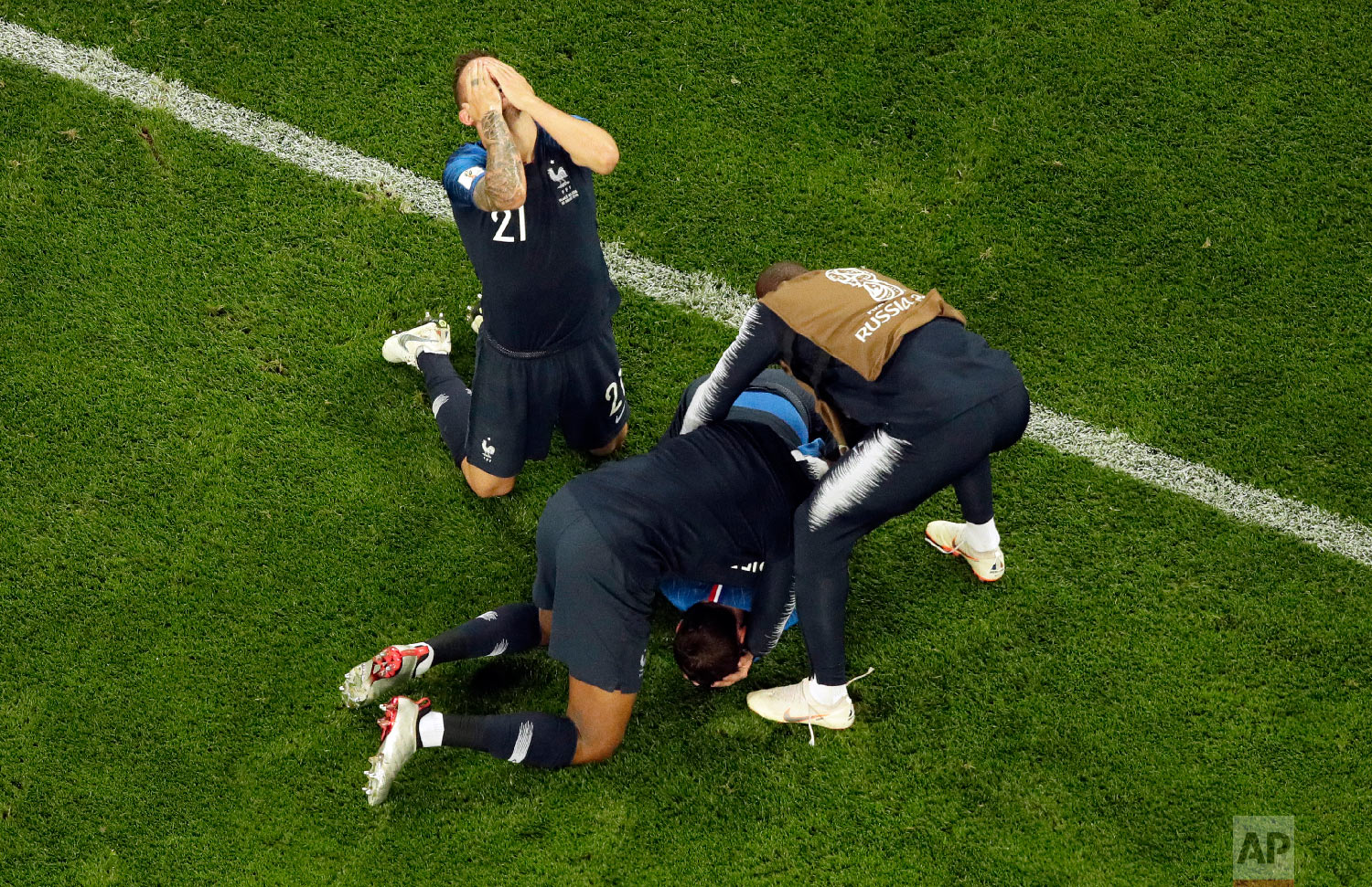 France players celebrate their victory after the the semifinal match between France and Belgium at the 2018 soccer World Cup in the St. Petersburg Stadium in St. Petersburg, Russia, Tuesday, July 10, 2018. (AP Photo/Dmitri Lovetsky)