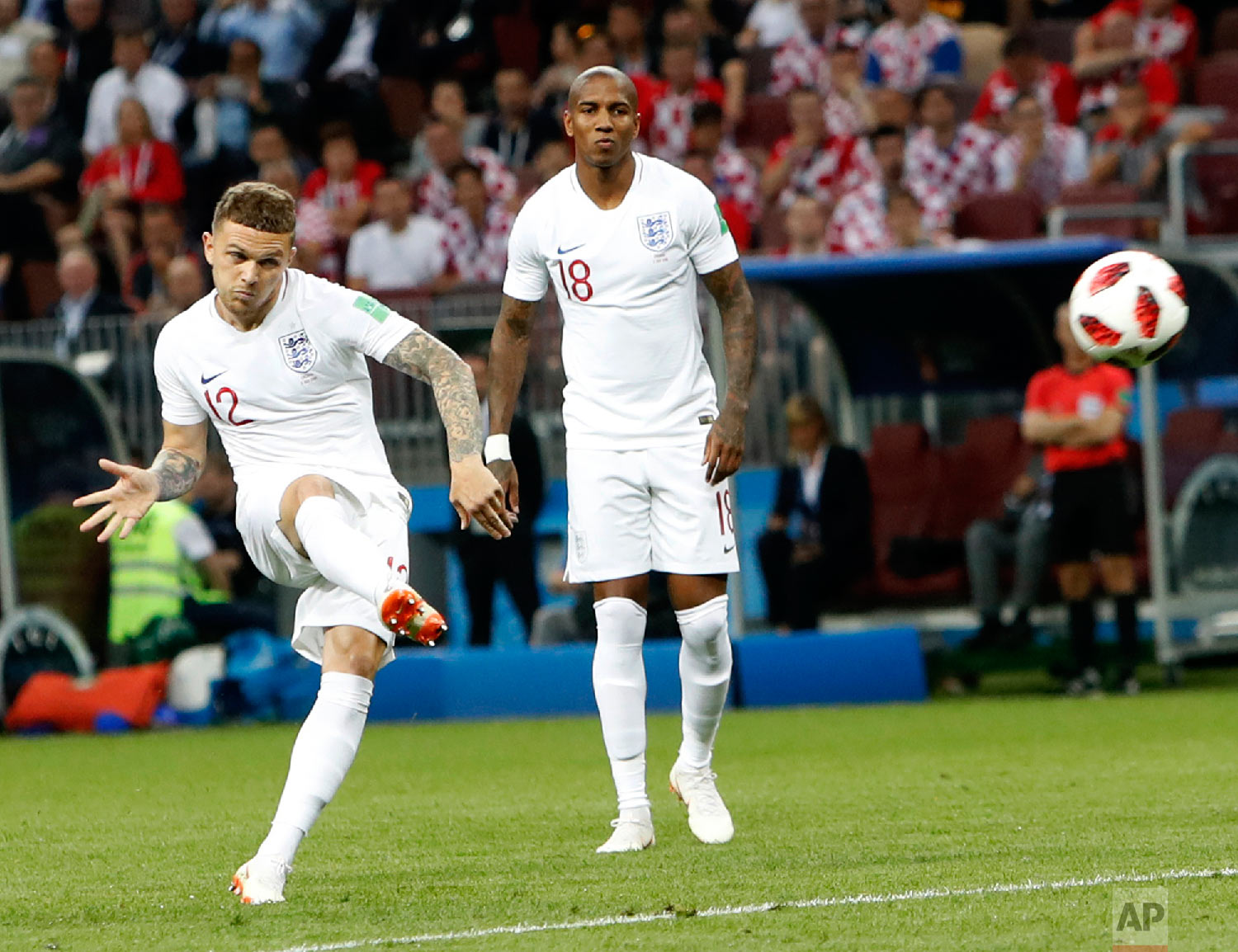 England's Kieran Trippier scores his side's opening goal during the semifinal match between Croatia and England at the 2018 soccer World Cup in the Luzhniki Stadium in, Moscow, Russia, Wednesday, July 11, 2018. (AP Photo/Alastair Grant)