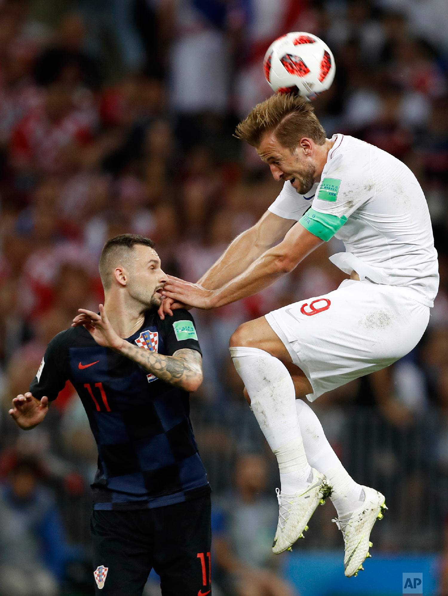 England's Harry Kane, right, challenges for the ball Croatia's Marcelo Brozovic, left, during the semifinal match between Croatia and England at the 2018 soccer World Cup in the Luzhniki Stadium in Moscow, Russia, Wednesday, July 11, 2018. (AP Photo/Francisco Seco)