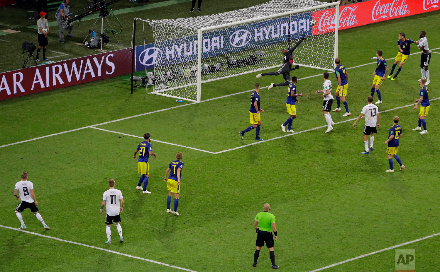 Germany's Toni Kroos, far left, scores his side's second goal during the group F match between Germany and Sweden at the 2018 soccer World Cup in the Fisht Stadium in Sochi, Russia on June 23, 2018. (AP Photo/Sergei Grits)