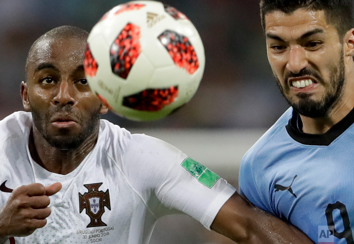 Uruguay's Luis Suarez, right, challenges for the ball with Portugal's Ricardo during the round of 16 match between Uruguay and Portugal at the 2018 soccer World Cup at the Fisht Stadium in Sochi, Russia on June 30, 2018. (AP Photo/Andre Penner)