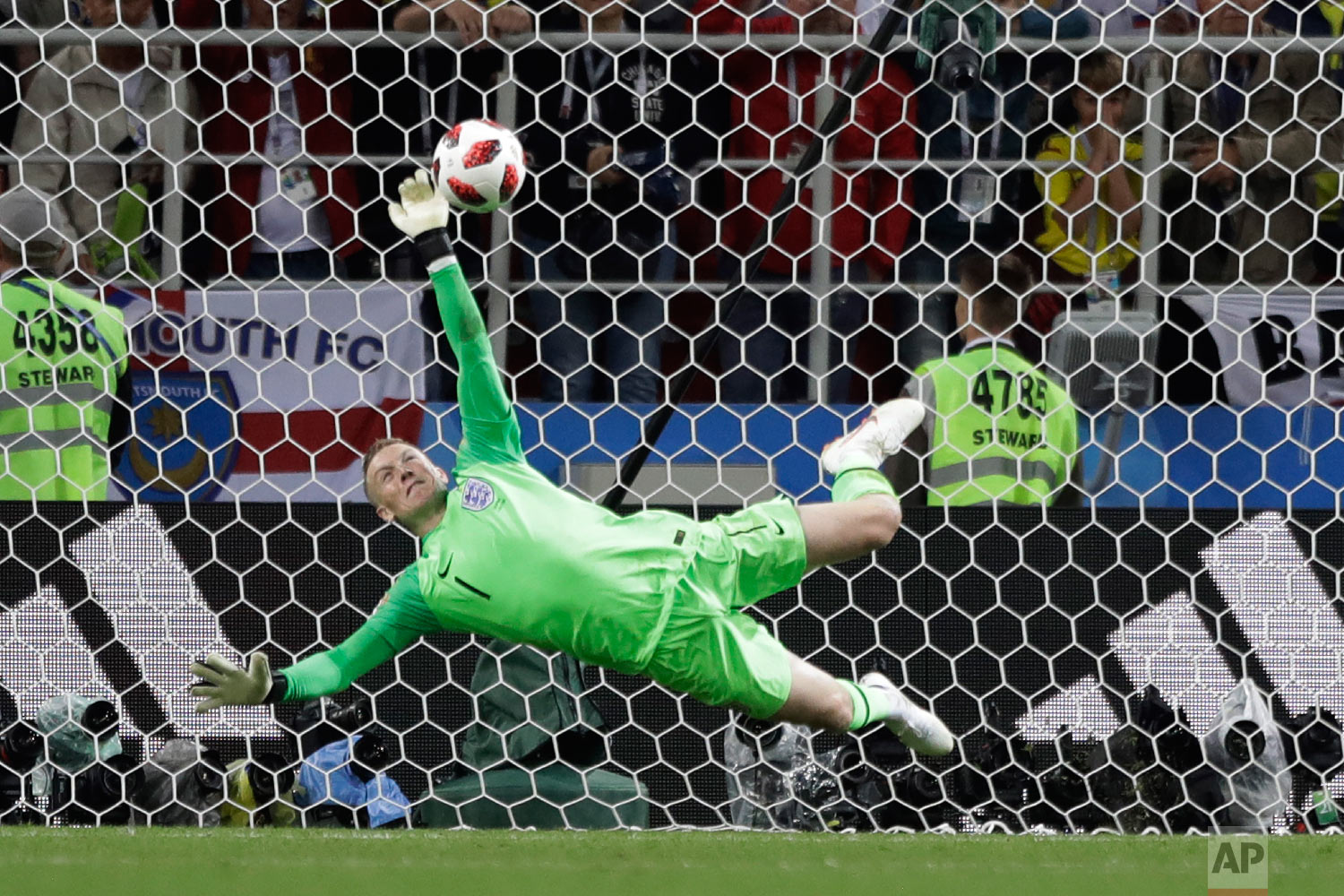England goalkeeper Jordan Pickford saves a penalty during the round of 16 match between Colombia and England at the 2018 soccer World Cup in the Spartak Stadium, in Moscow, Russia on July 3, 2018. (AP Photo/Matthias Schrader)