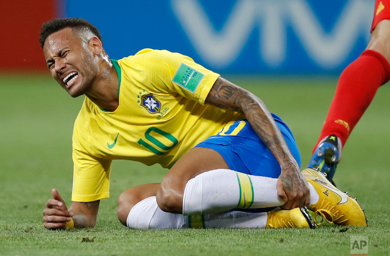 Brazil's Neymar holds his shinbone during the quarterfinal match between Brazil and Belgium at the 2018 soccer World Cup in the Kazan Arena, in Kazan, Russia on July 6, 2018. (AP Photo/Francisco Seco)