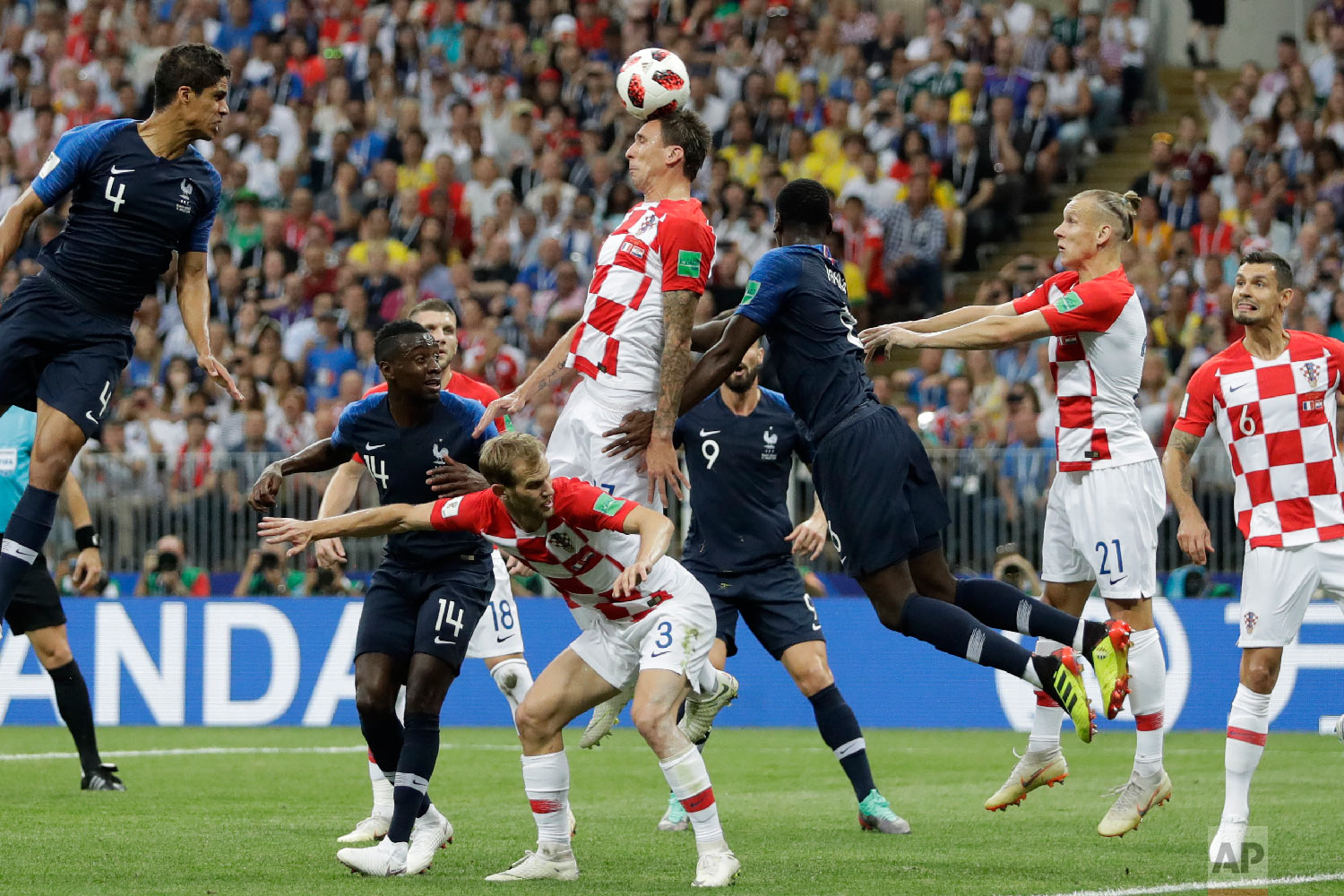 Croatia's Mario Mandzukic, center, scores an own goal during the final match between France and Croatia at the 2018 soccer World Cup in the Luzhniki Stadium in Moscow, Russia, Sunday, July 15, 2018. (AP Photo/Matthias Schrader)