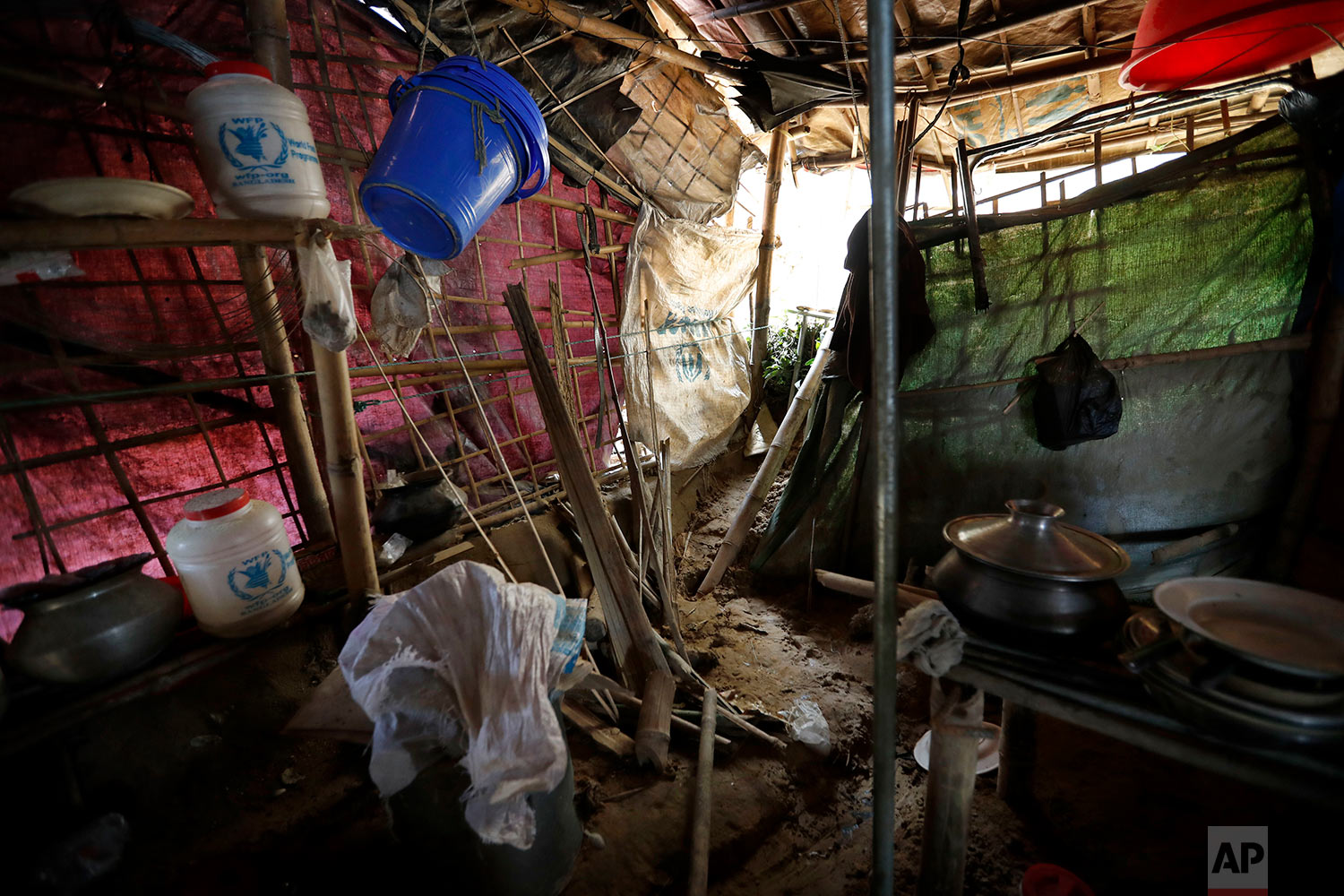 In this Wednesday, June 27, 2018, photo, the home of Abu Bakker, destroyed by a landslide, is seen in Chakmarkul refugee camp in Bangladesh. (AP Photo/Wong Maye-E)