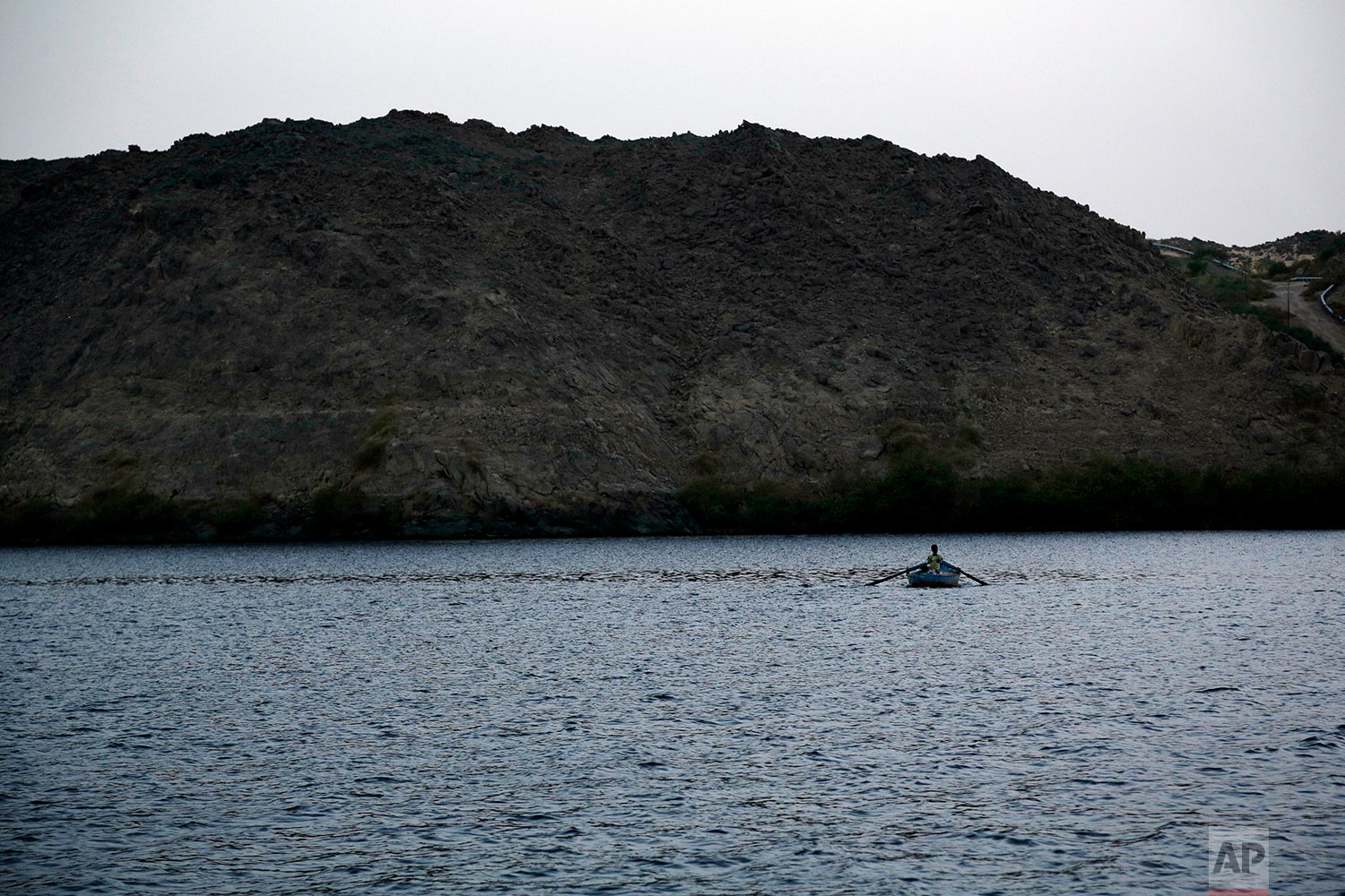 A man rows his boat near on the Nile River in front of Heisa Island, in Aswan, Egypt.(AP Photo/Nariman El-Mofty)