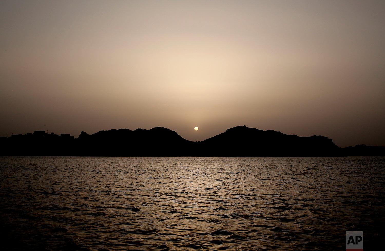 The sun sets near Heisa Island, Aswan, Egypt.(AP Photo/Nariman El-Mofty)