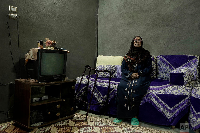 "85-year-old grandmother Naemah Hussein sits in her home ""tahgeer"" Eneiba village, northern Aswan, Egypt. (AP Photo/Nariman El-Mofty)"