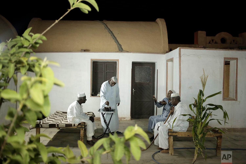 Nubian men talk at a home in Wadi Karkar, a new complex under construction in the desert west of Lake Nasser, Aswan, Egypt.(AP Photo/Nariman El-Mofty