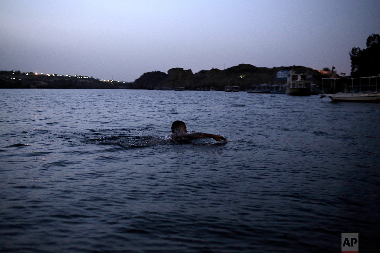 A Nubian man swims in the Nile River on Heisa Island, in Aswan, Egypt.(AP Photo/Nariman El-Mofty)