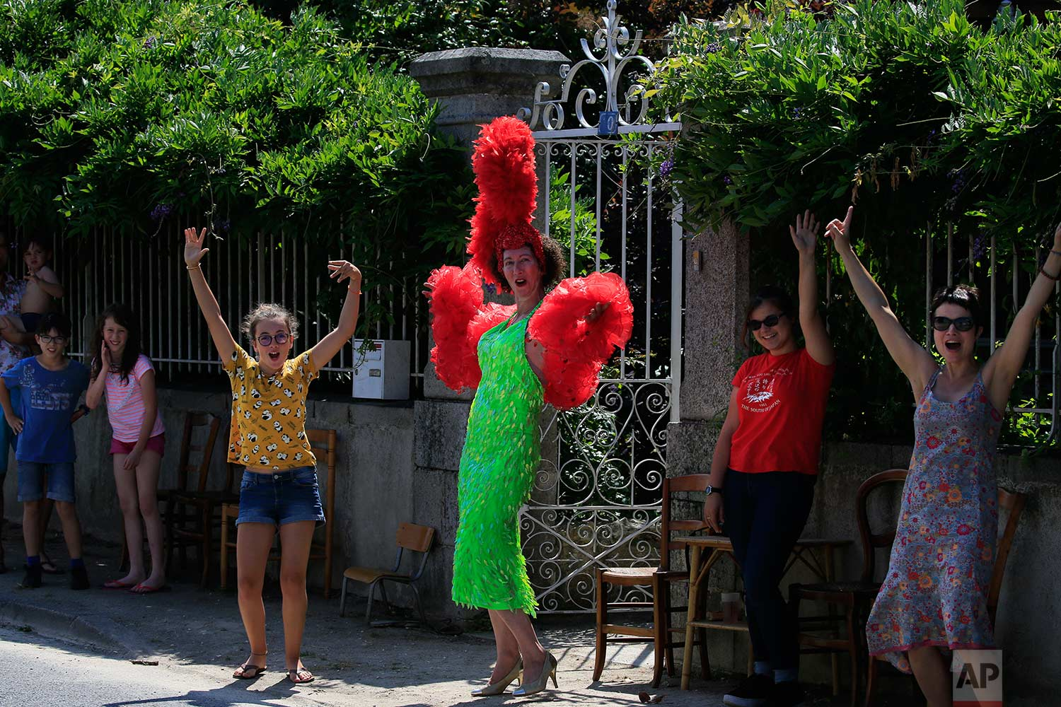 Spectators cheer as they wait for the riders to pass during the second stage of the Tour de France cycling race over 182.5 kilometers (113.4 miles) with start in Mouilleron-Saint-Germain and finish in La Roche Sur-Yon, France, Sunday, July 8, 2018. (AP Photo/Peter Dejong)