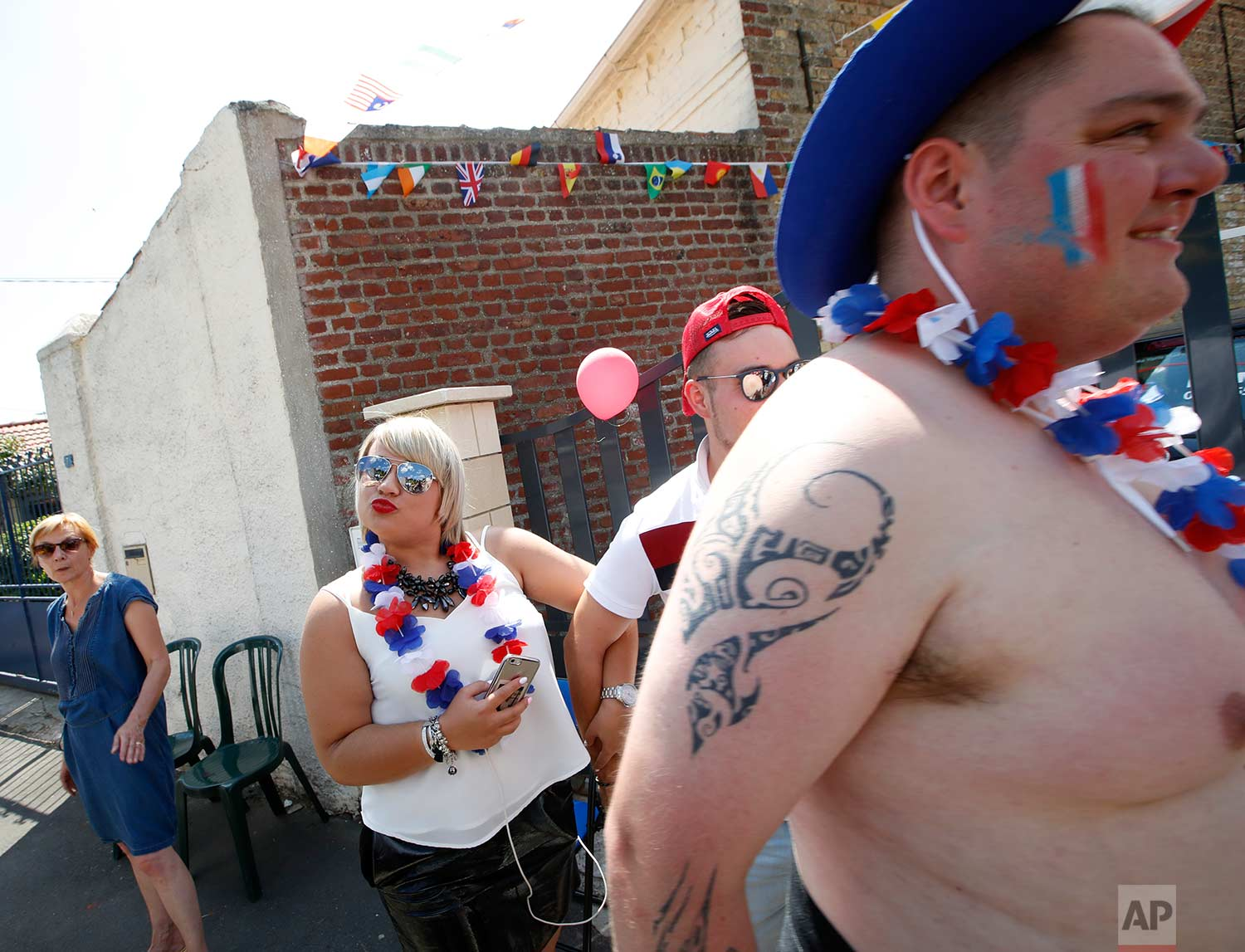 Spectators wait for the pack to pass during the ninth stage of the Tour de France cycling race over 156.5 kilometers (97.2 miles) with start in Arras and finish in Roubaix, France, Sunday, July 15, 2018. (AP Photo/Christophe Ena)