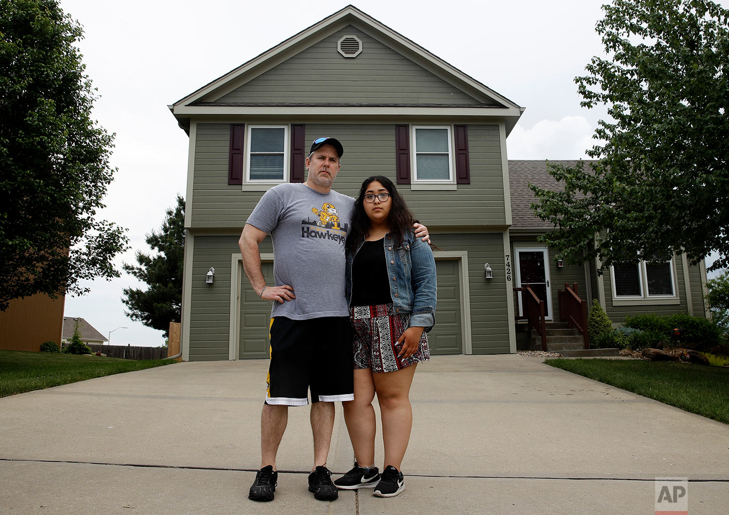 Jennifer Tadeo-Uscanga, 17, and her stepdad Steve Stegall stand outside their Kansas City, Mo. home they shared with wife and mother Letty Stegall. (AP Photo/Charlie Riedel)
