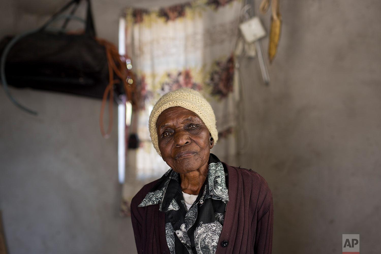 Ellis Ndlovu, 91, poses for a photograph in her Simbumbumbu, Zimbabwe home. (AP Photo/Jerome Delay)
