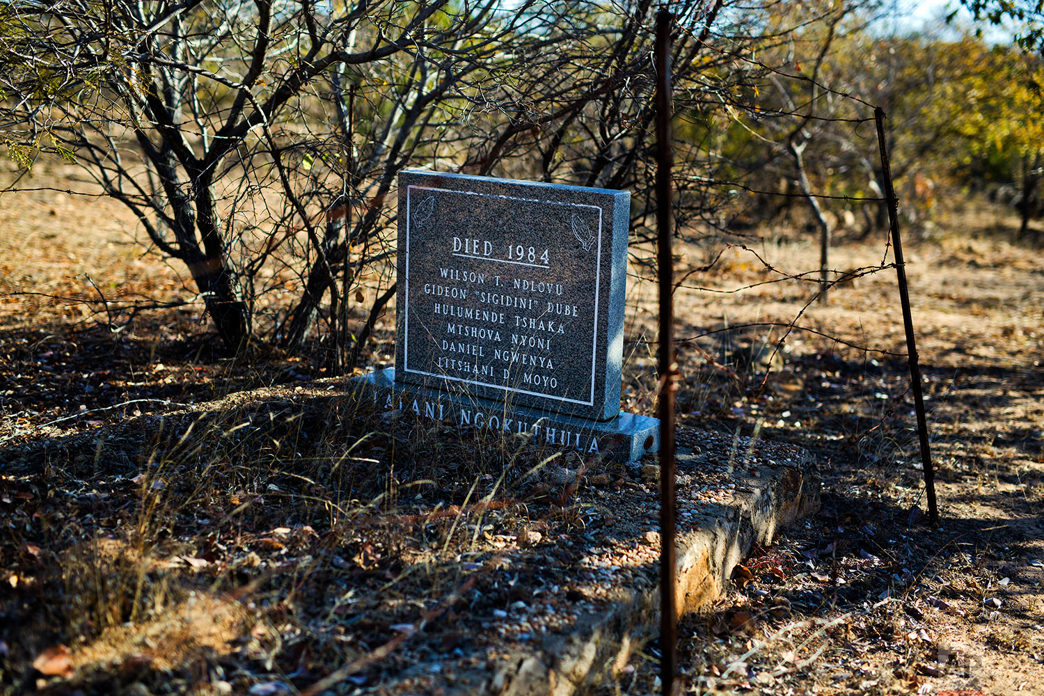 A mass grave bearing the names of six victims of the the Matabeleland Massacres, near the now abandoned Zimbabwean Sitezi military camp. (AP Photo/Jerome Delay)