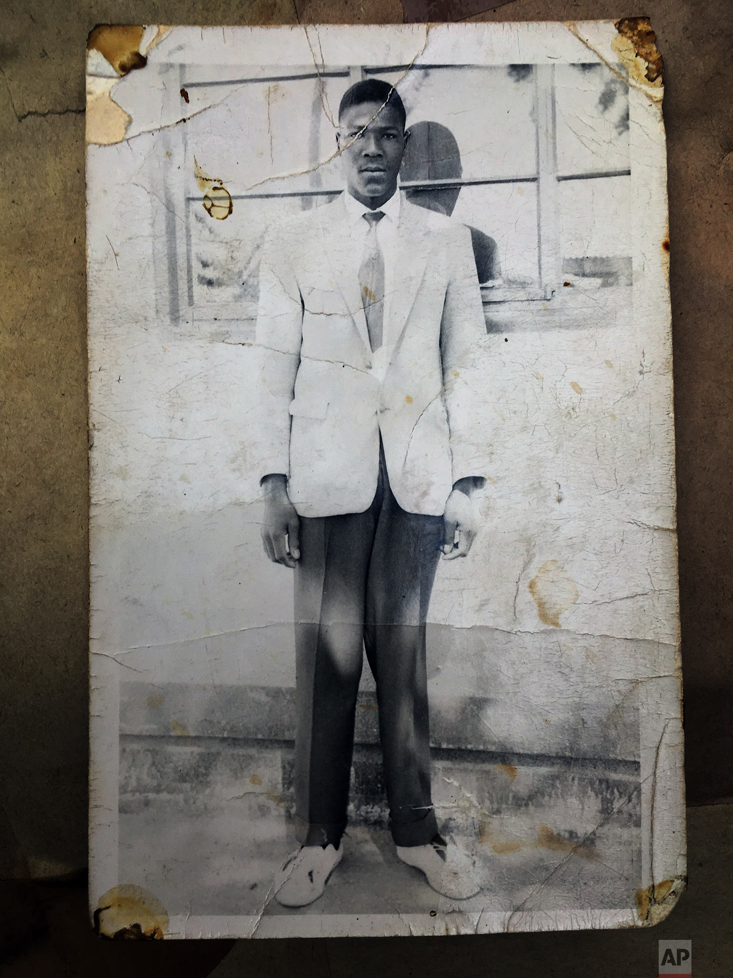 This photograph provided by the family shows Julius Mvulo Nyathi, before he was killed over 30 years ago by Zimbabwean soldiers during the Matabeleland Massacres. (AP Photo/Family of Julius Mvulo Nyathi)