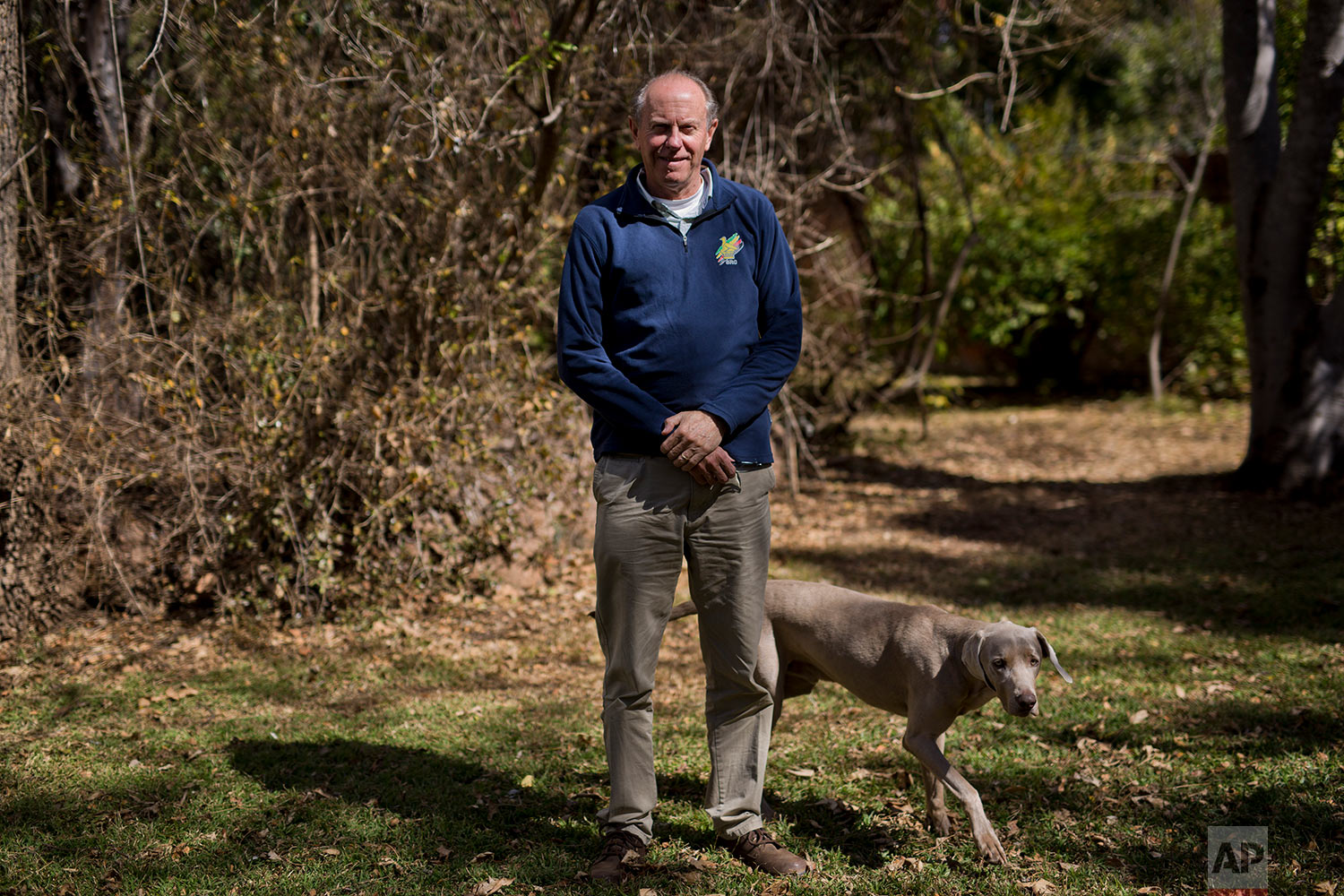 Human rights lawyer and opposition candidate in the July 30 legislative elections David Coltart poses in the garden of his residence in Bulawayo, Zimbabwe. (AP Photo/Jerome Delay)