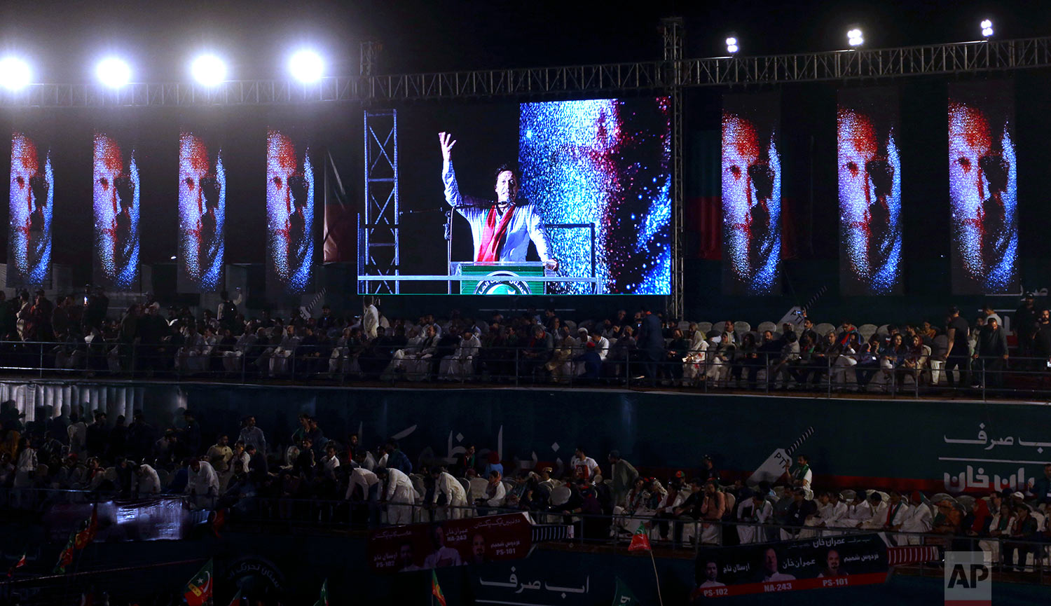 Pakistani politician Imran Khan, chief of Pakistan Tehreek-e-Insaf party, addresses his supporters during an election campaign rally in Karachi, Pakistan, Sunday, July 22, 2018. Pakistan will hold general election on July 25. (AP Photo/Shakil Adil)