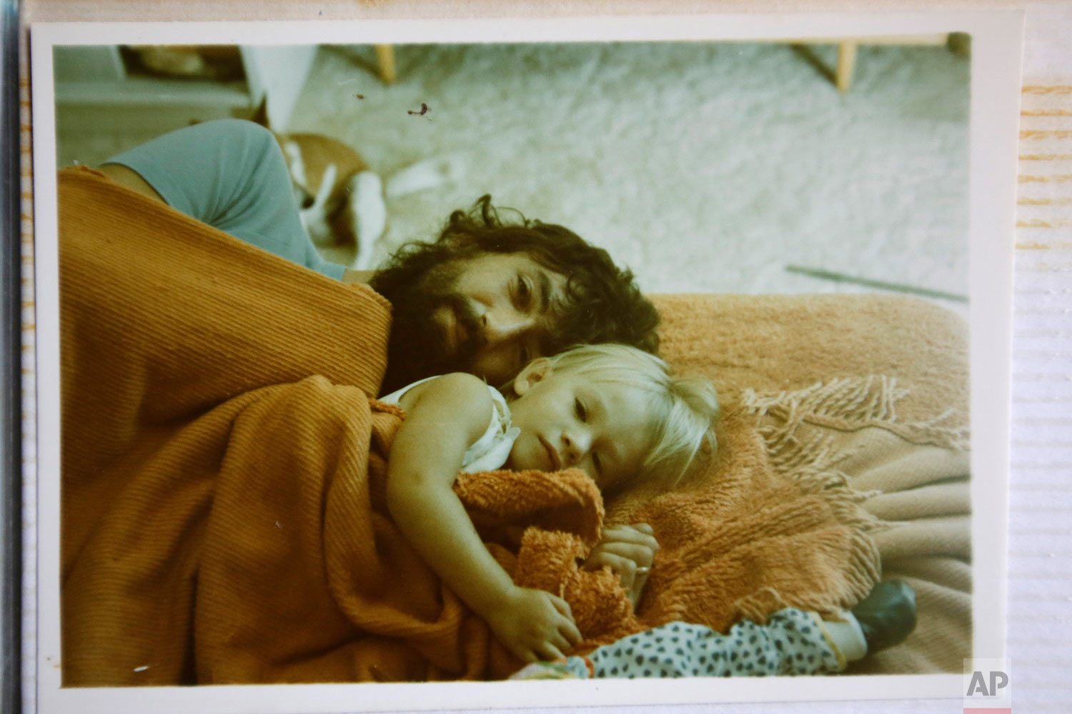 A photograph of Peter Peacock and his elder daughter, Melanie, in 1979, as they lay on the floor, in Melbourne, Australia. (AP Photo/Wong Maye-E)